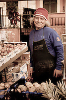 Man selling his fresh produce at the Pigneto Markets, Rome, Italy