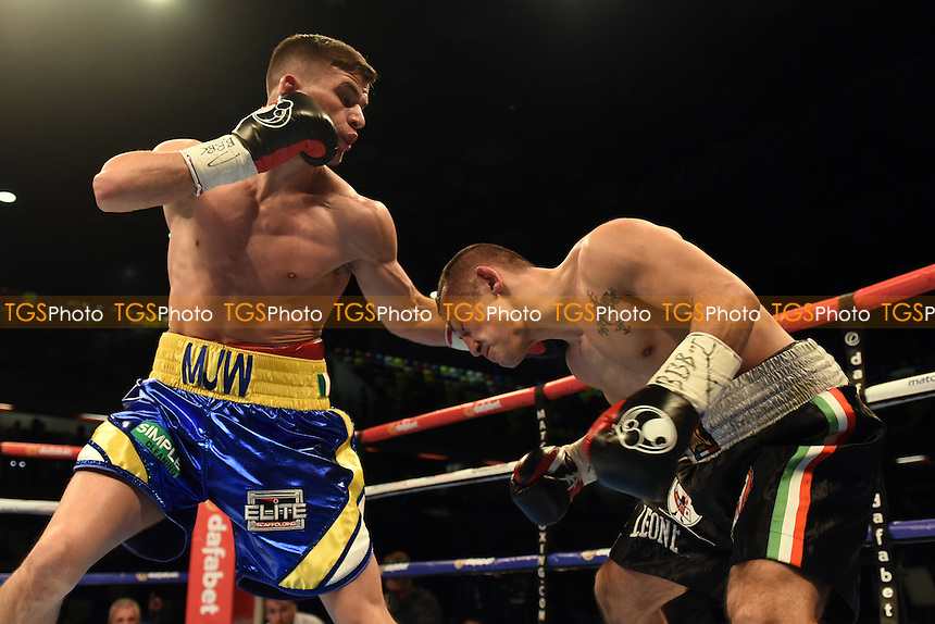 Martin J Ward (blue/yellow shorts) defeats Mario Pisanti to win the WBC International Super-Featherweight Title during a Boxing show at the Copper Box Arena, promoted by Matchroom Sports