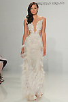 Model walks runway in a feather illusion gown, from the Christian Siriano for Kleinfeld bridal collection, at Kleinfeld on April 18, 2016 during New York Bridal Fashion Week Spring Summer 2017.