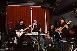 The WIld Koba, a rock band, performs at The Fifth Estate in Park Slope Brooklyn.  David Kobayashi, lead guitar, Jason Isaac, drums, Umesh Goswami, guitar Robert Johnston, bass and Greg Madama, vocals