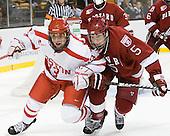 Garrett Noonan (BU - 13), Dan Ford (Harvard - 5) - The Harvard University Crimson defeated the Boston University Terriers 5-4 in the 2011 Beanpot consolation game on Monday, February 14, 2011, at TD Garden in Boston, Massachusetts.