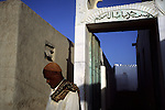 Outside a mosque in the port city of Gwadar.  Once a part of the sultanate of Oman, Gwadar was given to Pakistan in 1958.  However, it retains its Arabic culture, and is also home to a large population of descendents of African slaves who transited through this town.