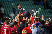 Serbia players toss up their coach, Veljko Paunovic, after winning the FIFA Under-20 Football World Cup Final between Brazil (gold) and Serbia at North Harbour Stadium, Albany, New Zealand on Saturday, 20 June 2015. Photo: Dave Lintott / lintottphoto.co.nz