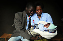CHIKUMBLITSO POLOPO, 31 WHO WAS HELPED BY THE GOOD SAMARITAN PROJECT IN HIS VILLAGE OF LUCHENZA, MALAWI, WITH HIS WIFE PATRICIA, 22, AND THEIR 7 WEEK OLD BABY, JOY. . PICTURE BY CLARE KENDALL. 2/11/12