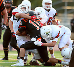 SIOUX FALLS, SD - AUGUST  28: Logan Eckhoff #18 from Washington is brought down by a host of defenders from Brandon Valley in the first half of their game Friday night at Howard Wood Field. (Photo by Dave Eggen/Inertia)