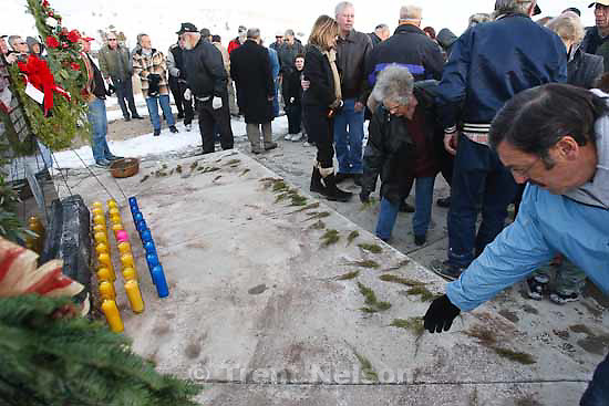 Small pieces of evergreen are left at a memorial for the 27 people who died in the Wilberg Mine disaster 25 years ago today, Saturday, December 19, 2009.