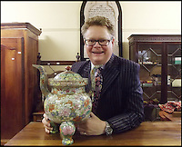 BNPS.co.uk (01202 558833)<br /> Pic: Charterhouse/BNPS<br /> <br /> ***Please use full byline***<br /> <br /> Delighted Richard Brommel.<br /> <br /> How much does a chinese urn?....&pound;153,000 over its estimate.<br /> <br /> A broken Chinese urn that had been stored on top of a wardrobe and covered in dust for 20 years has sold at auction for &pound;155,000 - &pound;153,000 over its estimate.<br /> <br /> The owner, a man aged in his 50s, had inherited the urn from a relative decades ago and thought it was nothing more than a pot pourri holder.<br /> <br /> As the dust was wiped away a beautiful hand-painted design was revealed showing ornate flowers in pink, green, blue, and red.<br /> <br /> It was suspected that the piece dated back to the 1800s when China was under the rule of the Quianlong Emporer, and it was estimated to sell for &pound;2,000 at auction.<br /> <br /> The lot caused a frenzy of bidding with buyers from around the world placing bids over the phone, by internet, and in the sale room, and it finally sold for &pound;154,250.<br /> <br /> The unnamed owner, from Shaftesbury in Dorset, said that it was the 'best day of his life' after the ancient artefact sold for 75 times what he was expecting.<br /> <br /> It was sold by Charterhouse Auctioneers in Sherborne.