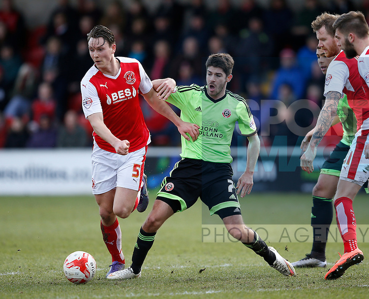 Eggert Jonsson of Fleetwood Town tackled by Ryan Flynn of Sheffield Utd - English League One - Fleetwood Town vs Sheffield Utd - Highbury Stadium - Fleetwood - England - 5rd March 2016 - Picture Simon Bellis/Sportimage
