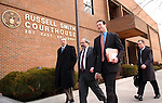Agriculture Undersecretary Mark Rey, second from left, walks out of the Missoula Federal Court House with his attorneys and witnesses on Tuesday Feb. 26, 2008 in Missoula, Mont. The Bush administration official appeared before a federal judge Tuesday, urging him not to hold the U.S. Forest Service in contempt over the use of a fire retardant that environmentalists say kills fish and plants.  (AP Photo/James Snook)