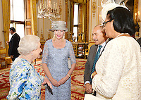 10 June 2016 - London, England - Queen Elizabeth II talks to Sir Jerry Mateparae of New Zealand and Dame Cecile La Grande (right) of Grenada, during a reception ahead of the Governor General's lunch at Buckingham Palace in London. Photo Credit: ALPR/AdMedia