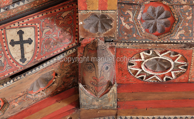 Detail of the ceiling of the Upper Hermitage of the Santuario de la Virgen de la Fuente, or Sanctuary of the Virgin of the Fountain, showing mudejar wooden panelling with carved and painted floral, heraldic and anthropomorphic decoration, Penarroya de Tastavins, Matarrana, Teruel, Aragon, Spain. In the 13th century, an image of the Virgin Mary was discovered beside a spring in this spot, and a chapel was built, which was replaced in the 14th century by a Gothic building. The Upper Hermitage was begun in 1341 in Aragonese Gothic style. It has one nave in 5 sections with a wooden roof decorated in mudejar style, with Calatrava crosses and heraldic symbols. The hermitage was declared a Spanish National Monument in 1941 and a UNESCO World Heritage Site in 2001 under the Mudejar Art bracket. Picture by Manuel Cohen