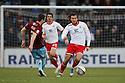 Lawrie Wilson of Stevenage evades Eddie Nolan of Scunthorpe. Scunthorpe United v Stevenage - npower League 1 - Glanford Park, Scunthorpe - 21st January, 2012. © Kevin Coleman 2012