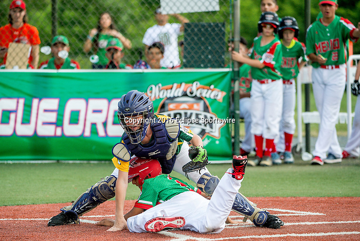 ABERDEEN, MD - AUGUST 02: Guillermo Garcia #9 of Mexico safely slides into home as Brandon Dumler #11 of Australia cannot hold on to the ball in a game between Australia and Mexico during the Cal Ripken World Series at The Ripken Experience Powered by Under Armour on August 2, 2016 in Aberdeen, Maryland. (Photo by Ripken Baseball/Eclipse Sportswire/Getty Images)