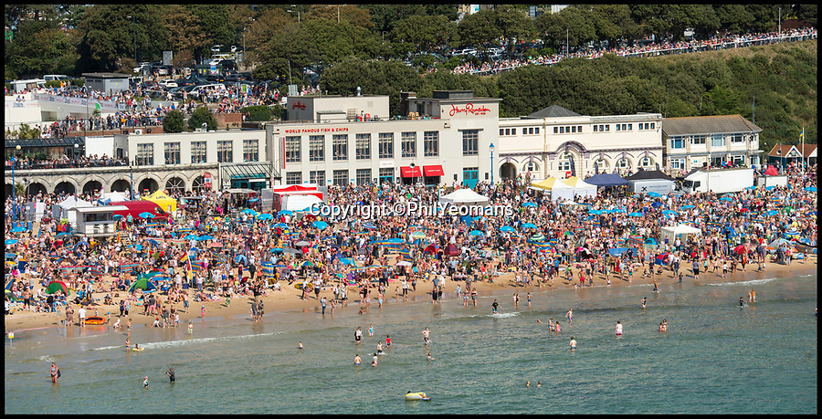 BNPS.co.uk (01202 558833)<br /> Pic: PhilYeomans/BNPS<br /> <br /> Yesterday an estimated 500,000 people crowded on to the cliffs and beaches to watch the air festival.<br /> <br /> Rain stops play...The Bournemouth Air Festival is cancelled today as rain and winds sweep in today.<br /> <br /> 500,000 crowded into Bournemouth yesterday for the south coast resort's annual air festival.<br /> <br /> It was difficult to see the sand on the beach as holidaymakers crowded onto the seven miles of seafront to watch the Red Arrows.