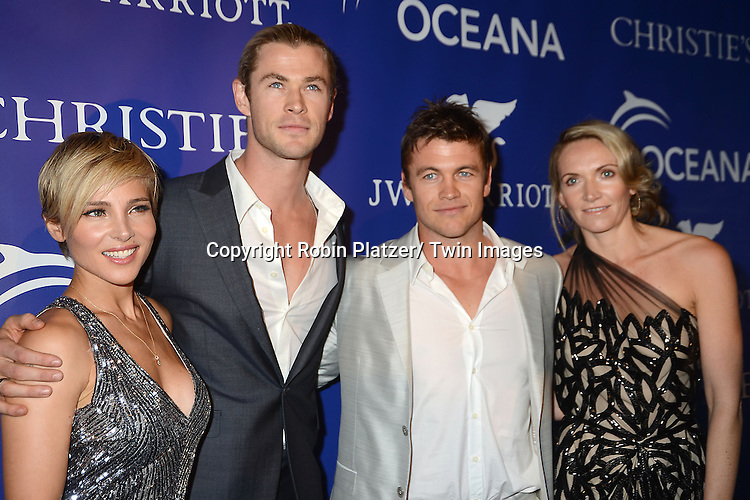 Elsa Pataky and husband Chris Hemsworth  and Luke Hemsworth attend the Inaugural Oceana Ball on April 8, 2013 at Christie's in New York City.