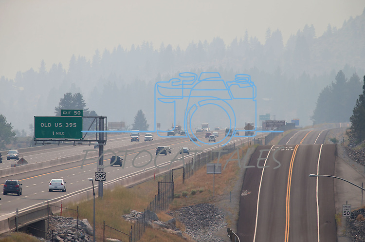 Traffic moves along I-580, near Washoe Valley, south of Reno, as heavy smoke from the Rim fire hangs over Northern Nevada on Friday, Aug. 23, 2013. <br /> Photo by Cathleen Allison