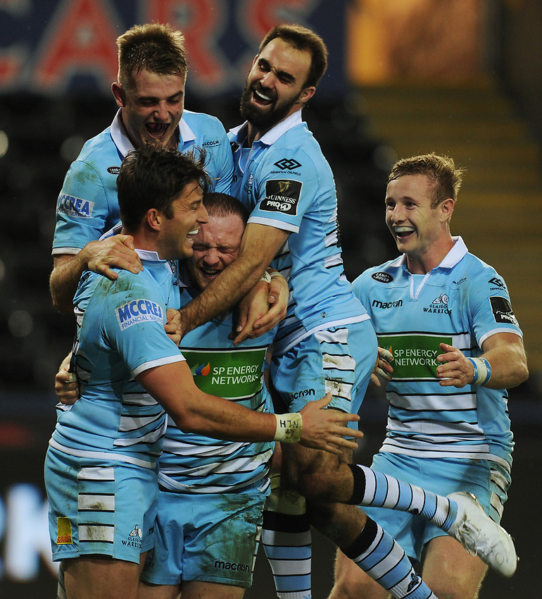 Glasgow Warriors' Nick Grigg is mobbed by team-mates as he celebrates scoring his sides fourth try<br /> <br /> Photographer Kevin Barnes/CameraSport<br /> <br /> Guinness Pro14 Round 8 - Ospreys v Glasgow Warriors - Friday 2nd November 2018 - Liberty Stadium - Swansea<br /> <br /> World Copyright © 2018 CameraSport. All rights reserved. 43 Linden Ave. Countesthorpe. Leicester. England. LE8 5PG - Tel: +44 (0) 116 277 4147 - admin@camerasport.com - www.camerasport.com