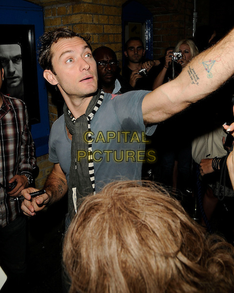 Jude Law signs autographs for his fans | CAPITAL PICTURES