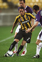 Phoenix's Leo Bertos takes the ball up the right wing during the A-League football match between Wellington Phoenix and Perth Glory at Westpac Stadium, Wellington, New Zealand on Sunday, 16 August 2009. Photo: Dave Lintott / lintottphoto.co.nz