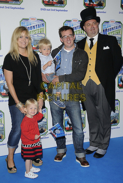 Jo Joyner with her family & 'butler'.The 'Thomas & Friends: Blue Mountain Mystery' UK film premiere, Vue West End cinema, Leicester Square, London, England..September 1st, 2012.full length kid child blue jeans denim jacket trousers yellow waistcoat grey gray trousers top hat black red dress top shirt .CAP/CAN.©Can Nguyen/Capital Pictures.