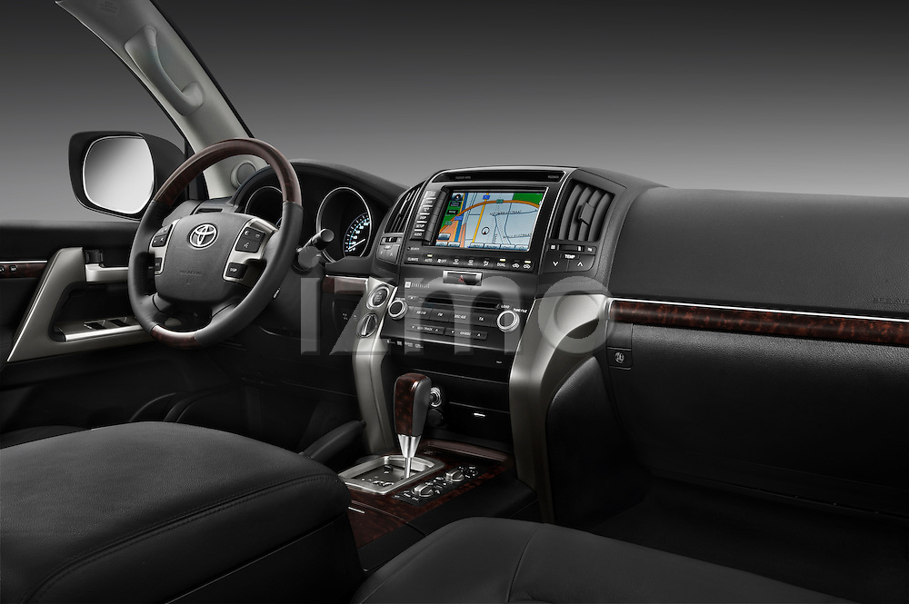 Passenger side dashboard view of a 2011 Toyota Land Cruiser V8 VX SUV.