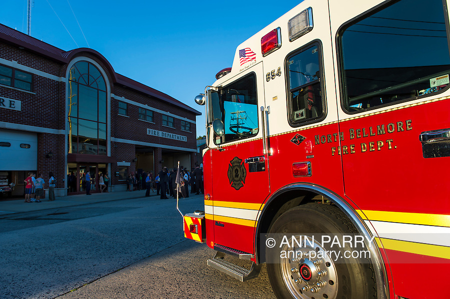 Bellmore, New York, USA. 11th September 2015. A North Bellmore Fire Dept. fire engine is parked in front of the Bellmore Fire House during the Bellmore Memorial Ceremony for 3 Bellmore volunteer firefighters and 7 residents who died due to 9/11 terrorist attack at NYC Twin Towers. Bellmore volunteer firefighters Lt. Kevin Prior and F.F. Adam Rand died on 9/11/2001, and F.F. Sean McCarthy died in 2008 due to illness related to working at scene of attack.