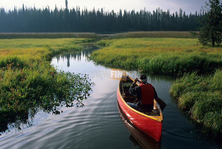 Man Paddling Red Canoe on Hosmer Lake