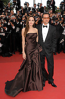 ANGELINA JOLIE &amp; BRAD PITT<br /> 'The Tree of Life' premiere at the Palais des Festival, 64th International Cannes Film Festival, France<br /> 16th May 2011<br /> full length strapless silk satin brown dress gown black tux tuxedo tinted glasses sunglasses shades couple gathered goatee facial hair photographers press<br /> CAP/PL<br /> &copy;Phil Loftus/Capital Pictures /MediaPunch ***NORTH AND SOUTH AMERICAS ONLY***