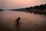 Joi Tipphavong bathes in the Mekong River in Ban Khe, a small village north of Pak Lai, Laos on Friday, March 7, 2008.  (photo by Khampha Bouaphanh)