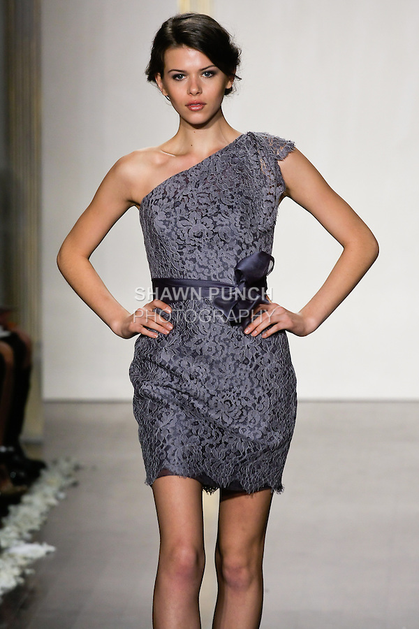 Model walks runway in a slate lace pencil skirt dress, one shoulder neckline, natural waist bridesmaid dress by Lazaro Perez, from the Noir by Lazaro Spring 2012 Bridal fashion show.
