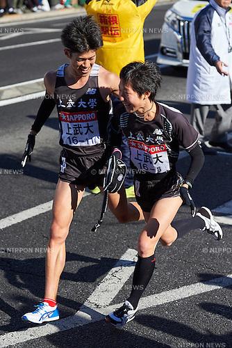 (L-R) Shohei Kurata , Kiyotaka Morita (Jobu Univ), <br /> JANUARY 2, 2015 - Athletics : The 91st Hakone Ekiden Race, Odawara Relay place in Kanagawa, Japan. (Photo by AFLO SPORT)
