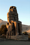 Colossi of Memnon, 60 foot high enthroned statues of the Pharaoh Amenhotep III (14th century BC) they stand on the flood plains on the West Bank of the River Nile at Thebes.This is the East (or North) Colossus.After an earthquake damaged it 'this statue emmitted strange sounds in the morning,perhaps due to the heat of the sun,or the humidity of the night.