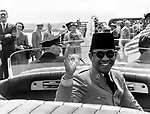 Washington, D.C.:   May 16, 1956 President Sukarno of Indonesia waves during a motorcade on his trip to the United States.
