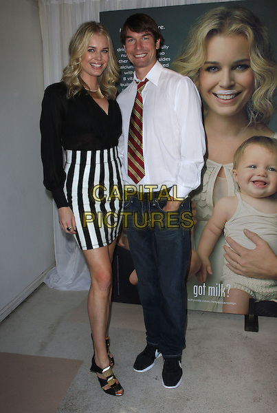 "REBECCA ROMIJN & JERRY O'CONNELL.Rebecca Romijn launches the National Milk Mustache ""got milk?"" held At The W Hotel, Westwood, California, USA..January 11th, 2009.full length black shirt white striped stripes skirt shirt red tie jeans denim married husband wife .CAP/ADM/KB.©Kevan Brooks/AdMedia/Capital Pictures."