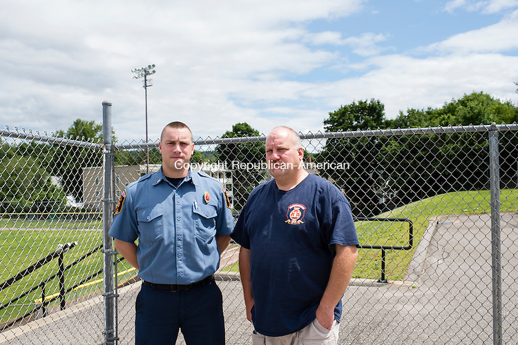 TORRINGTON, CT-29 June 2015-062915EC01-  28-year-old Robert Shopey, III stands with his father Robert Shopey Jr. in front of the area at Fuessenich Park in Torrington where the fireworks explosion took place 25 years ago. Erin Covey Republican-American