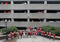Members of the Ohio State men's glee club use the acoustics between two parking garages northwest of the stadium to entertain tailgaters before the NCAA football game between the Ohio State Buckeyes and the Northern Illinois Huskies at Ohio Stadium on Saturday, September 19, 2015. The vocalists stop here every game day to sing and collect donations and sell cd's. (Columbus Dispatch photo by Jonathan Quilter)