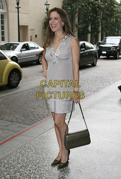 KELLY PRESTON .Step Up Women's Network 2008 Inspiration Awards Luncheon held at the Beverly Wilshire Hotel, Beverly Hills, California, USA, .09 May 2008.full length grey gray beaded neckline top beige gold skirt hand on hip brown shoes bag .CAP/ADM/RE.©Russ Elliot/Admedia/Capital PIctures