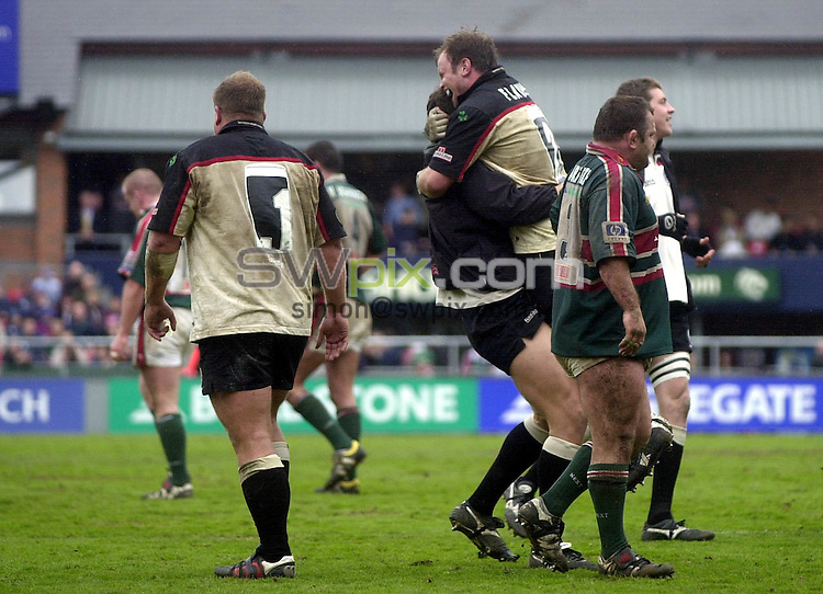 Pix: Matthew Lewis/SWpix.com. Rugby Union. Zurich Premiership. Leicester Tigers v London Irish. 03/05/03..COPYRIGHT PICTURE>>SIMON WILKINSON>>01943 436649>>..London Irish's Adrian Flavin celebrates his teams win over Leicester Tigers.