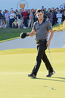 Emiliano Grillo (ARG) looks at his missed putt as he heads to congratulate Rickie Fowler (USA) on the match win during round 4 Singles of the 2017 President's Cup, Liberty National Golf Club, Jersey City, New Jersey, USA. 10/1/2017. <br /> Picture: Golffile | Ken Murray<br /> <br /> All photo usage must carry mandatory copyright credit (&copy; Golffile | Ken Murray)