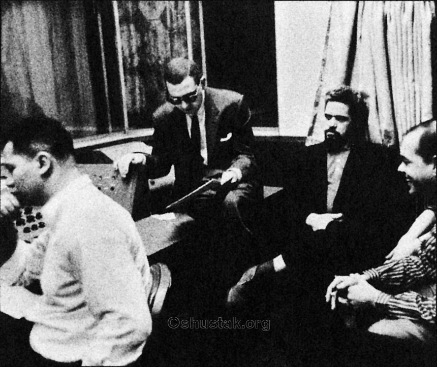 Engineer Ray Hall, A&R Director Jack Lewis, conductor Bill Potts and guitarist Herbie Powell in the control room… listening.