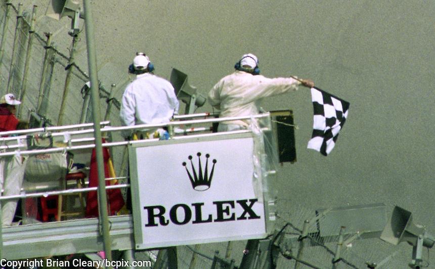 The checkered flag waves at the end of the 24 Hours of Daytona, IMSA race, Daytona International Speedway, Daytona Beach , FL, February 4, 1996.  (Photo by Brian Cleary/www.bcpix.com)