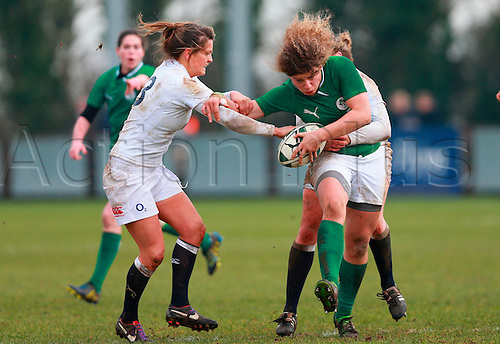 09.02.2013. Ashbourne RFC, Ireland. International Rugby Ireland Women versus England Women - Ashbourne RFC.     Jennifer Murphy (Ireland) attempts to drive through the English cover.