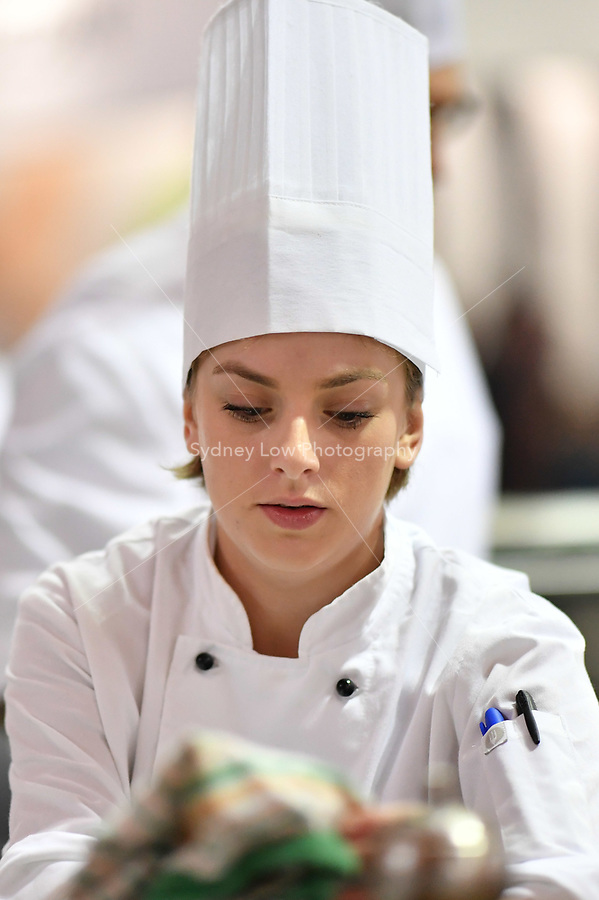 Melbourne, 30 May 2017 - Brooke Noble commis chef assisting Andrew Ballard of the Simmer Culinary in Mornington in action at the Australian selection trials of the Bocuse d'Or culinary competition held during the Food Service Australia show at the Royal Exhibition Building in Melbourne, Australia. Photo Sydney Low