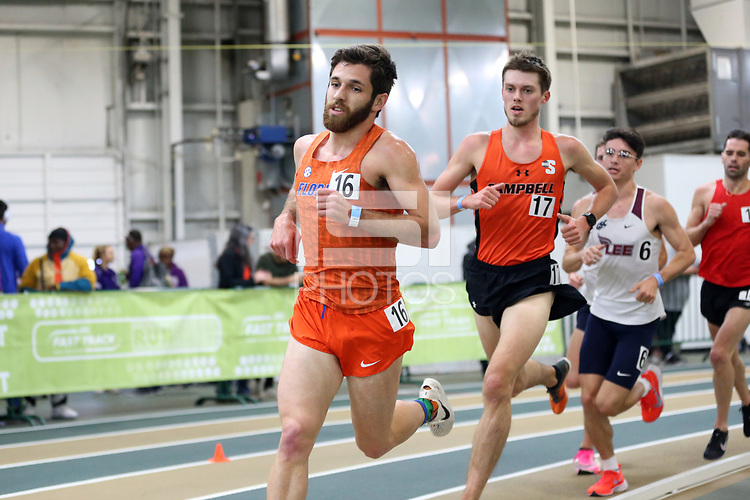 WINSTON-SALEM, NC - FEBRUARY 07: Black Lowery #16 of the University of Florida and Hunter Gilbert #17 of Campbell University compete in the Men's 5000 Meters at JDL Fast Track on February 07, 2020 in Winston-Salem, North Carolina.