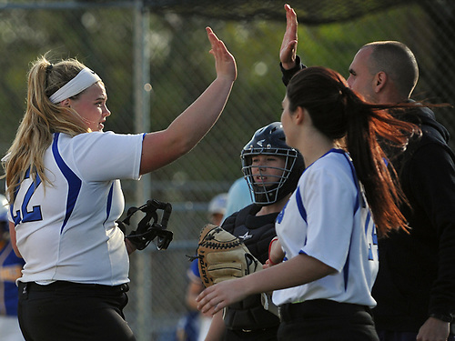 Ava Shorr #22, North Babylon pitcher, left, gets congratulated after pitching her team to a 4-1 win over West Islip in a Suffolk County League V varsity softball game at North Babylon High School on Wednesday, May 9, 2018.