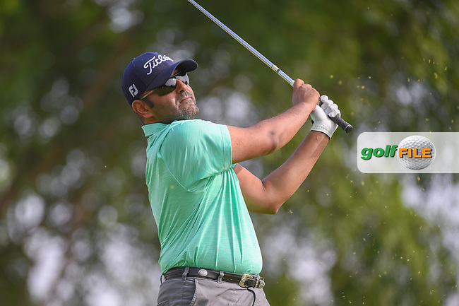 Saqer ALNOAIMI (BHR) watches his tee shot on 4 during Rd 1 of the Asia-Pacific Amateur Championship, Sentosa Golf Club, Singapore. 10/4/2018.<br /> Picture: Golffile | Ken Murray<br /> <br /> <br /> All photo usage must carry mandatory copyright credit (© Golffile | Ken Murray)