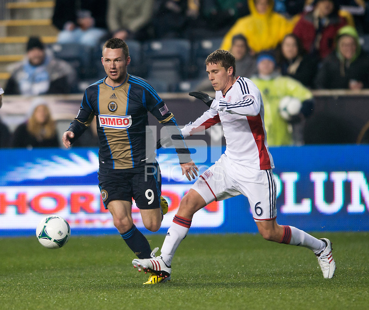 Jack McInerney (9) of the Philadelphia Union steps out of the tackle of Scott Caldwell (6) of the New England Revolution during the game at PPL Park in Chester, PA.  The Philadelphia Union defeated the New England Revolution, 1-0.
