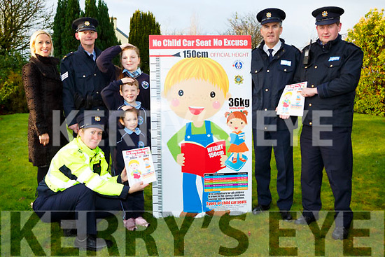 Killarney Garda launched their No Child Seat No Excuse campaign in Kilcummin NS l-r: Gillian Sheehan Principal, Sargent Dermot O'Connell, Garda Deirdre Quinn,EllaSophie Lawlor, Dara Keane, Helena O'Sullivan,  Chief Superintendent Flor Murphy and Garda Peter McCarthy