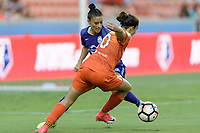 Houston, TX - Saturday June 17, 2017: Carli Lloyd attempts to dribble the ball around Ali Krieger during a regular season National Women's Soccer League (NWSL) match between the Houston Dash and the Orlando Pride at BBVA Compass Stadium.