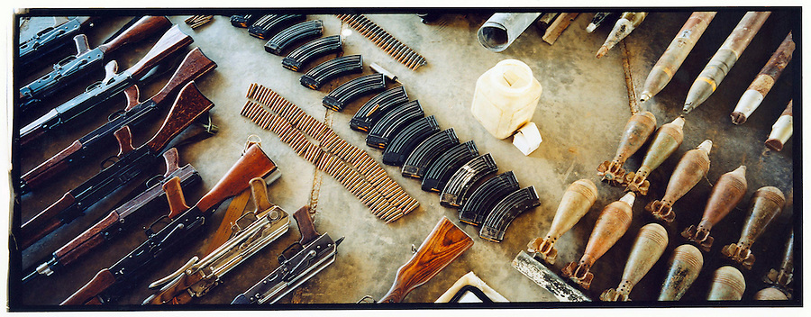 A cache of weapons is laid out for documentation after its discovery by soldiers with 4BN 23rd Infantry Regiment 172nd Stryker Brigade during the search of a mosque in the Baghdad Sunni neighborhood of Ghazaliyah on Wednesday August 16, 2006.  The raid, which yielded weapons and IED making materials, was part of an operation by bolstered US and Iraqi forces carried out in the hopes of putting a stop to the extraordinary numbers of sectarian killings in Baghdad.